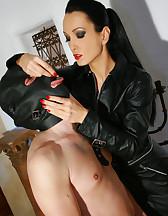 Leather Domina uses sub as ashtray, pic #13