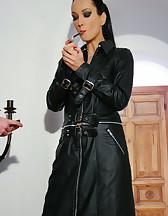 Leather Domina uses sub as ashtray, pic #3